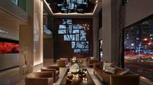 A jigsaw mosaic of LED screens displays a curated collection of multimedia work at the Quin Hotel in New York.