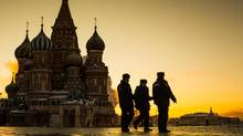 Police patrol Red Square in front of St. Basil's Cathedral in Moscow January 21, 2014. Security in Russia is on high alert after several bombings and threats leading up to the 2014 Winter Olympic Games in Sochi. (John Lehmann/The Globe and Mail)