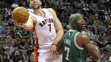 Toronto Raptors forward Andrea Bargnani puts up a shot against Boston Celtics forward Jermaine O'Neal (R) during the first half of their pre-season NBA basketball game in Toronto December 18, 2011. The Raptors face the Indiana Pacers in their regular season-opener on Wednesday. (MIKE CASSESE/REUTERS)