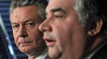 European Trade Commissioner Karel De Gucht listens to Canadian Trade Minister Peter Van Loan during a news conference in Ottawa on Dec. 15, 2010. (Chris Wattie/Reuters/Chris Wattie/Reuters)