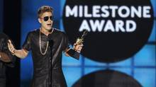 Musician Justin Bieber accepts the Milestone Award onstage during the Billboard Music Awards at the MGM Grand Garden Arena in Las Vegas. (STEVE MARCUS/REUTERS)