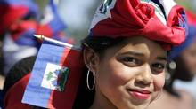 Celebrating Haitian Flag Day in the Miami neighbourhood of Little Haiti. (LYNNE SLADKY/AP)