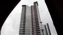 Concord Pacific's Cooper's Point towers have been painted sulphur yellow, ochre and terracotta. (John Lehmann/The Globe and Mail)