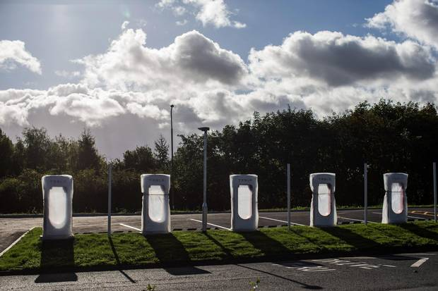 Tesla charging stations wait to be unwrapped at a service station off the M62 motorway near Bradford, U.K.
