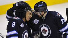 Winnipeg Jets' Blake Wheeler (R) celebrates his goal against the Florida Panthers with Evander Kane (9) during the third period of their NHL hockey game in Winnipeg March 1, 2012. (FRED GREENSLADE/REUTERS)