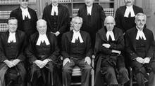 MAY 6, 1981: The nine justices of the Supreme Court of Canada. Top row, left to right, Julien Chouinard, Willard Estey, William McIntrye and Antonio Lamer. Front row, left to right, Robert George Brian Dickson (commonly known as Brian Dickson), Ronald Martland, Chief Justice Bora Laskin, Ronald Ritchie and Jean Beetz. (CP)