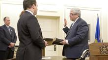Dave Hancock, right, is sworn in by Justice Minister Jonathan Denis as interim Alberta premier in Edmonton on March 23, 2014. (JASON FRANSON FOR THE GLOBE AND MAIL)
