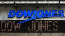 The Dow Jones financial electronic ticker is seen at Times Square in New York on July 17, 2012. (Shannon Stapleton/Reuters)