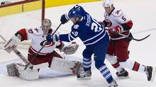 Carolina Hurricanes goaltender Cam Ward saves a shot from Toronto Maple Leafs centre David Steckel at the Air Canada Centre on Dec. 13, 2011. (Chris Young/The Canadian Press/Chris Young/The Canadian Press)