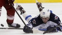 Winnipeg Jets center Mark Scheifele dives for the puck against the Phoenix Coyotes during the third period of their NHL hockey game in Glendale, Arizona October 15, 2011. REUTERS/Rick Scuteri (RICK SCUTERI)