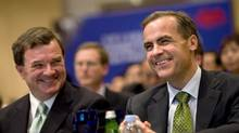 Finance Minister Jim Flaherty, left, and Bank of Canada Governor Mark Carney share a light moment during the Canadian Financial Forum in Beijing on Wednesday.