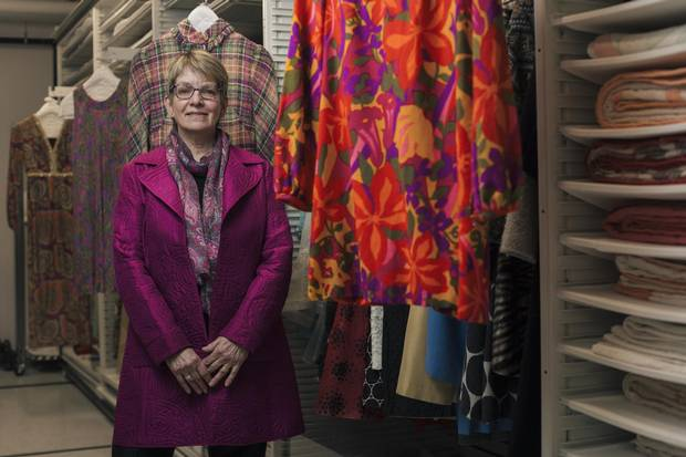 Lori Moran, amid the University of Alberta's Anne Lambert Clothing and Textiles Collection, says a new undergraduate course in the business of fashion is needed. 'We felt it has become increasingly relevant with changes in the global fashion industry.'