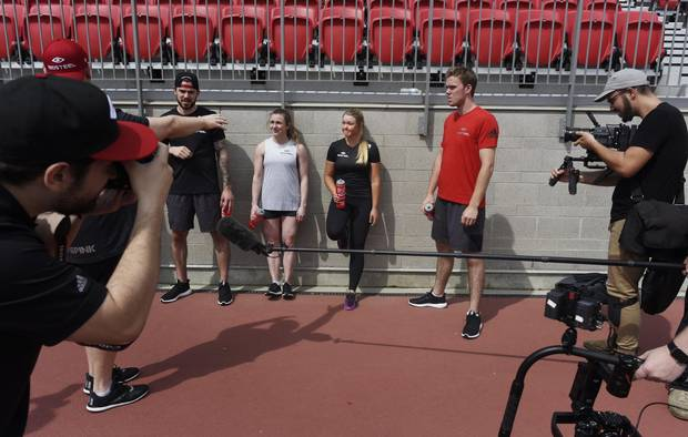Henderson, centre with red water bottle, during the BioSteel shoot with with NHL players Tyler Seguin, far left, and Conor McDavid, far right, and Olympic gymnast Rosie MacLennan, centre-left.