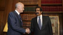 Greek Prime Minister George Papandreou, left, shakes hands with Qatar's Emir Sheikh Hamad bin Khalifa Al-Thani in Athens on Oct. 1, 2011. Qatar Holdings will invest $750-million European Goldfields, including $600-million to finance operations in Greece. (STR/Reuters)