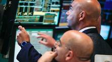 In a Tuesday, July 10, 2012, file photo, traders work at the start of early trading at the New York stock Exchange. U.S. stocks slid for a sixth day Thursday, July 12, 2012, as concern spread that weaker global economic growth and the European debt crisis will hurt U.S. corporate earnings. (Bebeto Matthews/AP Photo)