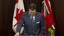 Ontario Finance Minister Dwight Duncan delivers his response to the Drummond report at a news conference in Toronto, Feb. 15, 2012. (Chris Young/The Canadian Press/Chris Young/The Canadian Press)