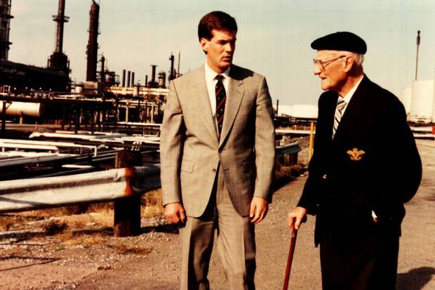 Kenneth Irving with his grandfather, K.C. Irving, at a refinery circa 1990.