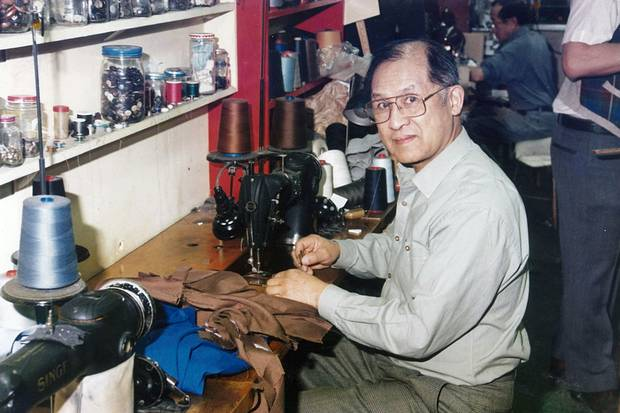 Bill Wong sits at his sewing machine in the Modernize tailor shop. Mr. wong died of heart failure last month, aged 95, after a decades-long tenure at a family business that became a Vancouver institution.