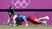 Czech Republic's Tomas Berdych dives for a return against Belgium's Steve Darcis during their men's singles match at the All England Lawn Tennis Club during the London 2012 Olympics Games on Saturday. (STEFAN WERMUTH/REUTERS)