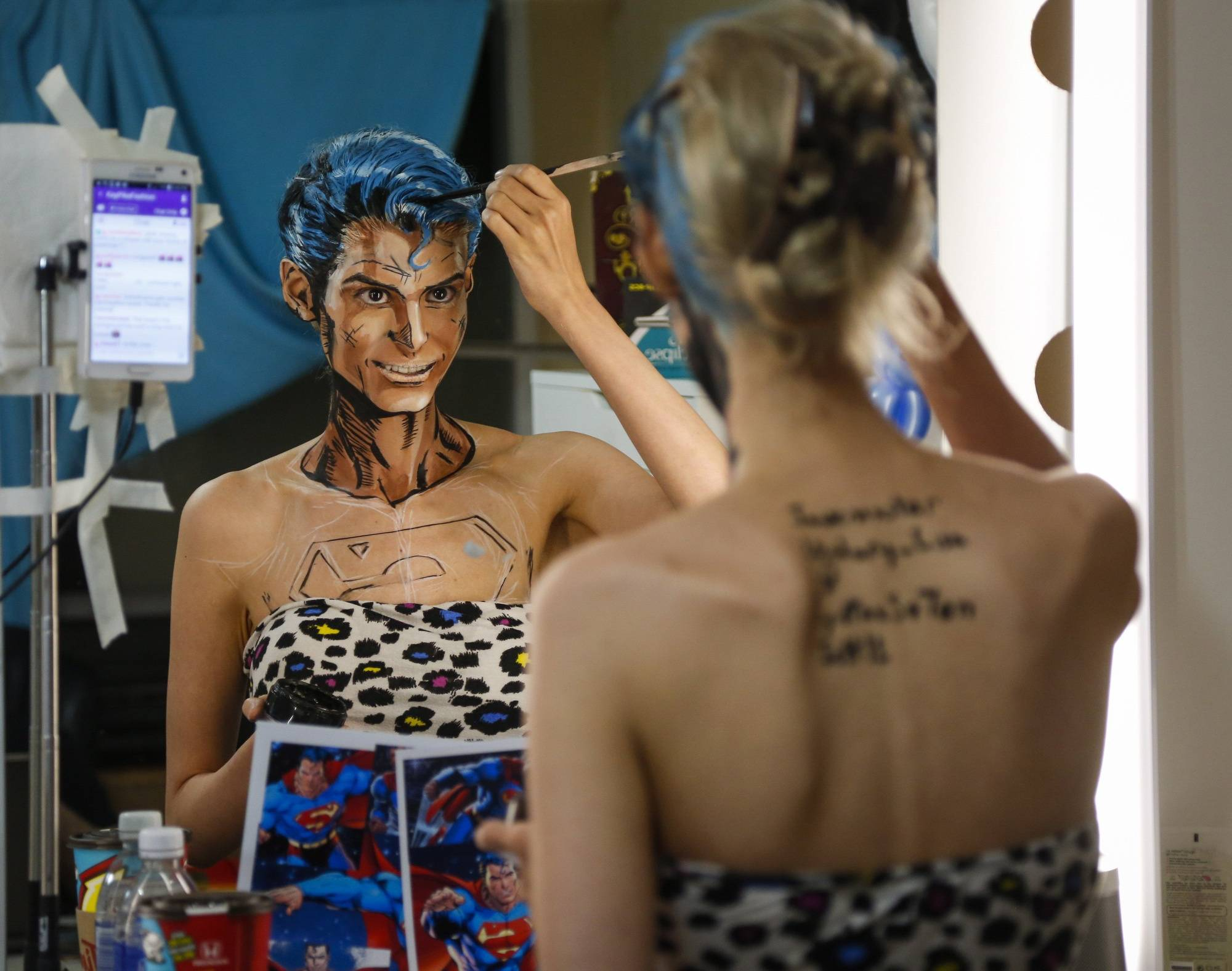 Calgary artist transforms herself into dark-haired Man of Steel for internet audience