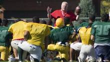 Toronto Mayor Rob Ford, in red, coaches football at Don Bosco Catholic Secondary School in Toronto on Wednesday, September 12, 2012. (Matthew Sherwood/Matthew Sherwood for The Globe a)