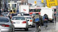 Cyclists and motorists commute to work in Toronto in May of 2008. (Tory Zimmerman/The Globe and Mail)
