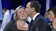 Ontario Progressive Conservative Party leader Tim Hudak kisses his wife Deb Hutton before he speaks to supporters at his election night campaign headquarters in Niagara Falls, Ontario, October 6, 2011. (MIKE CASSESE/REUTERS / Mike Cassese)