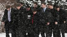 Friends and Lethbridge Bulls teammates carry the casket at the funeral for Tanner Craswell in Charlottetown on Dec. 23, 2011. Mr. Craswell, teammate Mitch MacLean and Tabitha Stepple of Lethbridge, Alta. were killed in a roadside shooting in Alberta last week. (Andrew Vaughan/THE CANADIAN PRESS/Andrew Vaughan/THE CANADIAN PRESS)