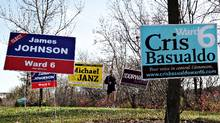 A jogger runs past campaign signs along River Valley Road in Edmonton, Alta., Oct. 17, 2010. Voters will head to the polls for municipal elections across Alberta on Oct. 18. (Jason Franson for The Globe and Mail)