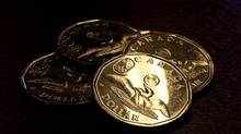 Canadian dollar coins. (Jeff McIntosh/THE CANADIAN PRESS)