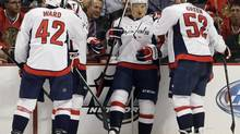Washington Capitals' Mikhail Grabovski (84), second from right, celebrates with teammates after scoring a goal during the second period of an NHL hockey game against the Chicago Blackhawks in Chicago, Tuesday, Oct.1, 2013. (Nam Y. Huh/AP)