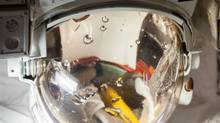 The spacesuit helmet worn by European Space Agency astronaut Luca Parmitano during a July 16 spacewalk that was cut short when the helmet began to fill with water is captured in a close-up image in the Quest airlock of the International Space Station. (NASA)