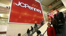 In this Friday, Oct. 23, 2009 photo, shoppers visit a J.C. Penney store in New York. (Mark Lennihan/Mark Lennihan/AP)