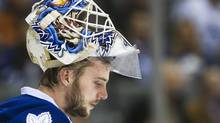 Toronto Maple Leafs goalie Jonas Gustavsson looks down after replacing James Reimer while playing against the Montreal Canadiens during third period NHL action in Toronto on Saturday, Feb. 11, 2012. (NATHAN DENETTE/THE CANADIAN PRESS)