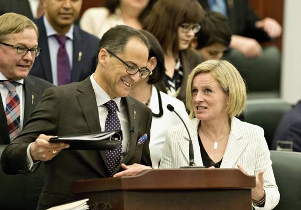 Premier Rachel Notley and Finance Minister Joe Ceci speak before delivering the 2016 budget in Edmonton.