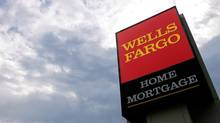 In this photograph taken July 19, 2010, the Wells Fargo logo is displayed on a sign outside one of the company's office buildings in Springfield, Ill. (Seth Perlman/AP)