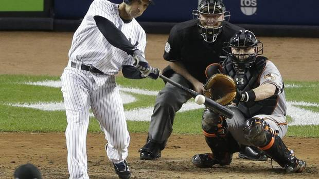 New York Yankees' Raul Ibanez hits a solo home run to tie the game in the ninth inning in Game 3 of the American League division baseball series against the Baltimore Orioles on Wednesday, Oct. 10, 2012, in New York. The Orioles catcher is Matt Wieters and the umpire is Brian Gorman. (Peter Morgan/AP)