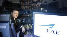 In this April 21, 2010 file photo, Marc Parent, president and CEO of CAE Inc., poses inside of flight simulator 737. (Christinne Muschi For The Globe and Mail)