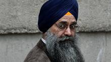 Inderjit Singh Reyat, the only man ever convicted in the Air India bombings of 1985, waits outside B.C. Supreme Court during a fire drill which forced everyone in the building outside prior to the start of the second day of his perjury trial in Vancouver, B.C., on Friday September 10, 2010. (Darryl Dyck/ The Canadian Press/Darryl Dyck/ The Canadian Press)