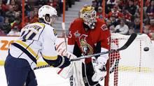 Nashville Predators' Matt Halischuk knocks the puck down behind Ottawa Senators' goalie Alex Auld during the first period of their NHL hockey game in Ottawa February 9, 2012. (BLAIR GABLE/REUTERS)