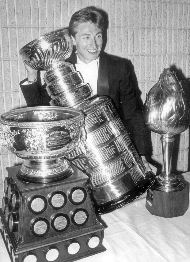 June 4, 1984. Edmonton Oiler hockey player Wayne Gretzky poses at last night's NHL awards dinner with some hardware he won for the past season.