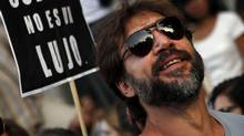 "Spanish actor Javier Bardem attends a protest against government austerity measures in Madrid July 19, 2012. A protest movement against the centre-right Spanish government's latest austerity measures swelled on Thursday as public sector workers stepped up demonstrations in Madrid and around the country after more than a week of spontaneous action. The placard reads, ""Culture is not a luxury."" (SUSANA VERA/REUTERS)"