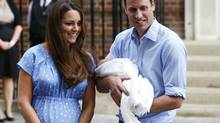 Britain's Prince William and his wife Catherine, Duchess of Cambridge appear with their baby son, as they stand outside the Lindo Wing of St Mary's Hospital, in central London July 23, 2013. Kate gave birth to the couple's first child, who is third in line to the British throne, on Monday afternoon, ending weeks of feverish anticipation about the arrival of the royal baby. (Lefteris Pitarakis/AP)