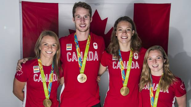Left to right: Canadian gold medalists Erica Wiebe, Derek Drouin, Penny Oleksiak and Rosie MacLennan on August 21, 2016 at the Rio 2016 Summer Olympics.