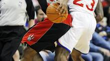 Toronto Raptors guard spins away from Philadelphia 76ers point Lou Williams (23) in the second half of an NBA basketball game, Wednesday, April 4, 2012, in Philadelphia. (Alex Brandon/AP)