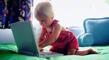 Toddler playing with laptop (© Thinkstock LLC)