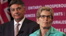 Ontario Premier Kathleen Wynne and Finance Minister Charles Sousa speak in Toronto on June 11, 2013, after the passing of the provincial budget. (MOE DOIRON/THE GLOBE AND MAIL)