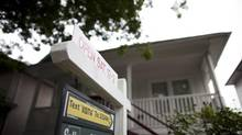 A for sale sign is seen in front a home in East Vancouver, British Columbia, Thursday, August 2, 2012. (Rafal Gerszak For The Globe and Mail)