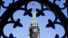 Canada's Maple Leaf flag flies atop a clock tower on Parliament Hill in Ottawa, Ontario, Canada, on Tuesday, March 24, 2009. (BLOOMBERG NEWS/Sean Kilpatrick/BLOOMBERG NEWS/Sean Kilpatrick)