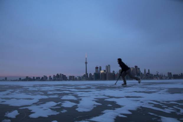 Maya Mittelstaedt skates across the frozen Toronto Harbour on Jan. 2, 2018.